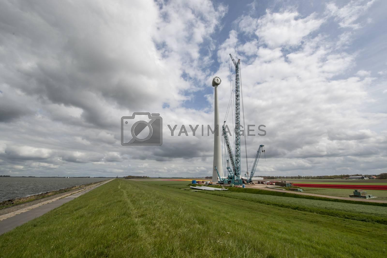 Construction of a modern windmill in the Noordoostpolder near the dyke of the IJsselmeer in Netherlands