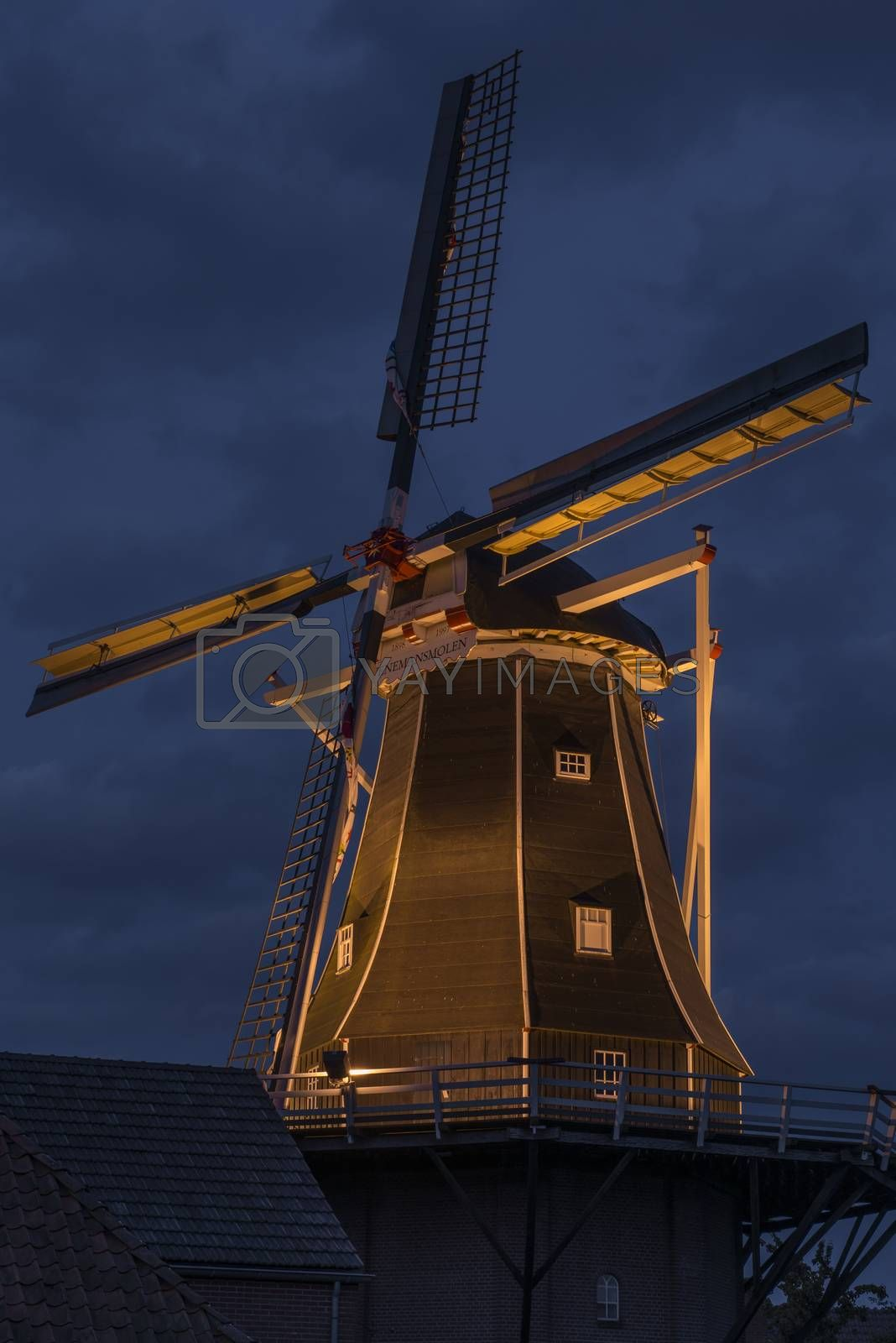 Authentic renovated windmill in Winterswijk in the east of the Netherlands in special illumination during in the beginning of the evening.