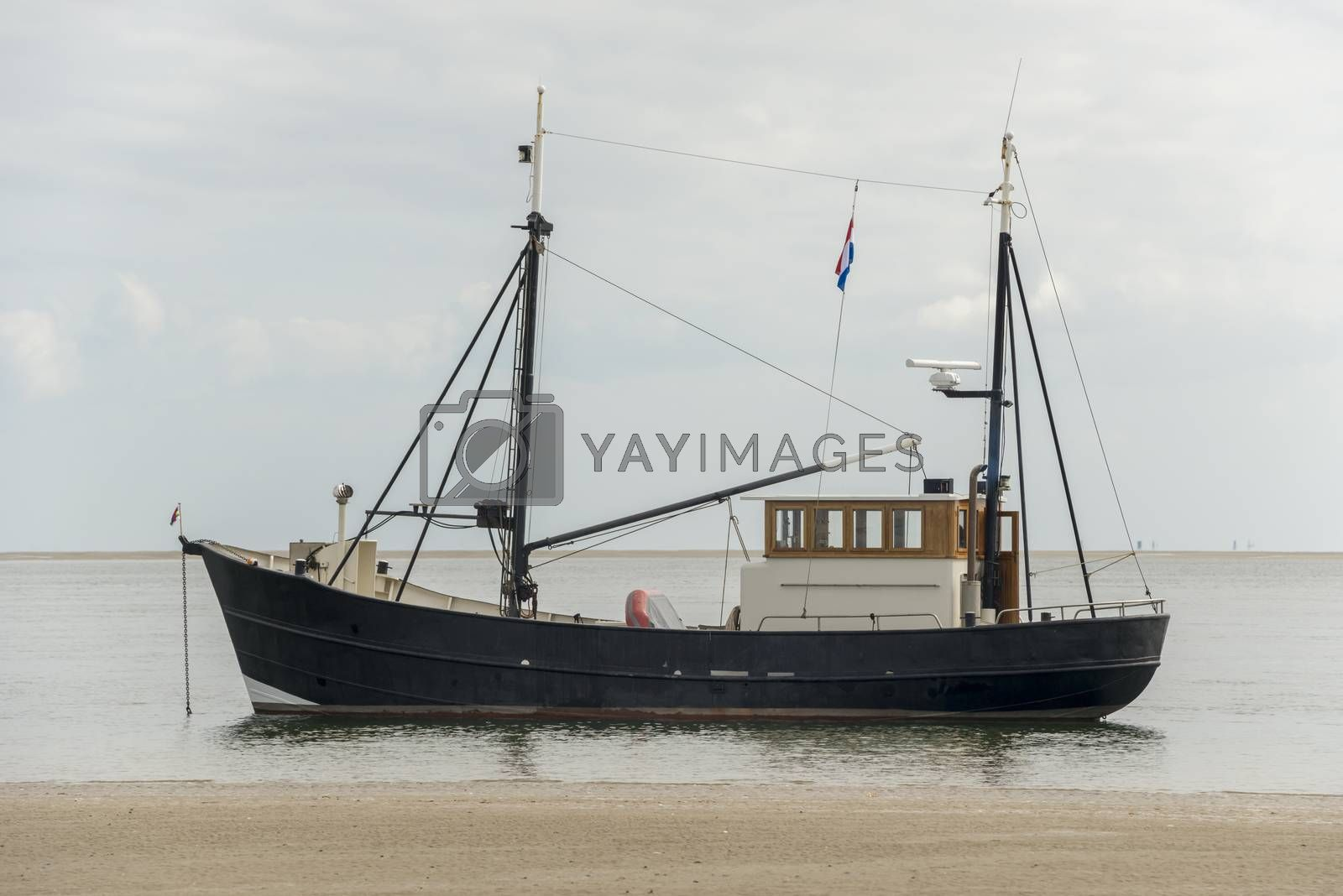 Fishing boat near the beach on the Dutch Wadden Sea