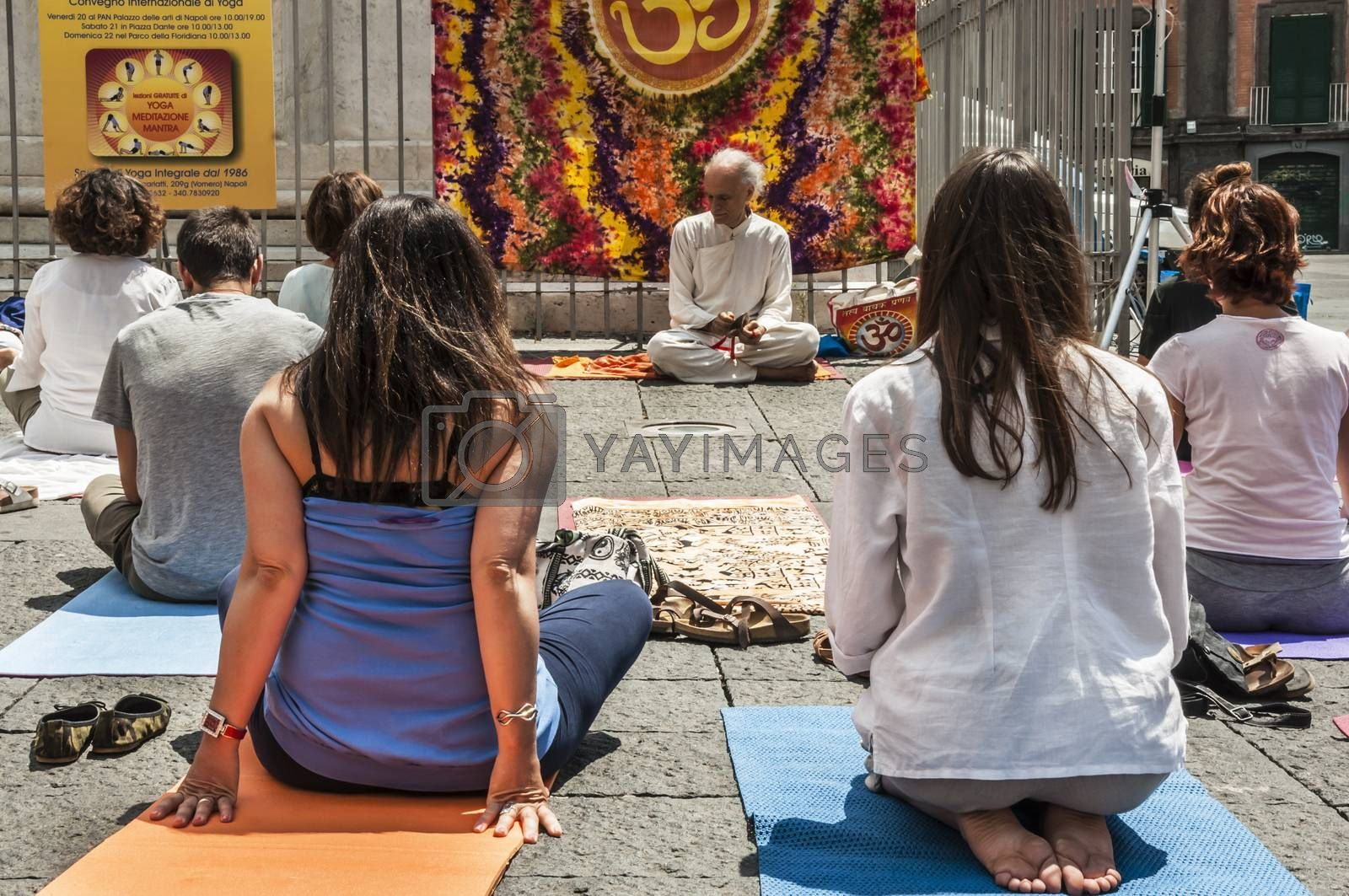 NAPLES - JUNE 21: people have yoga practice with a an expert and old man on the street on June 21, 2014 in Naples, Italy