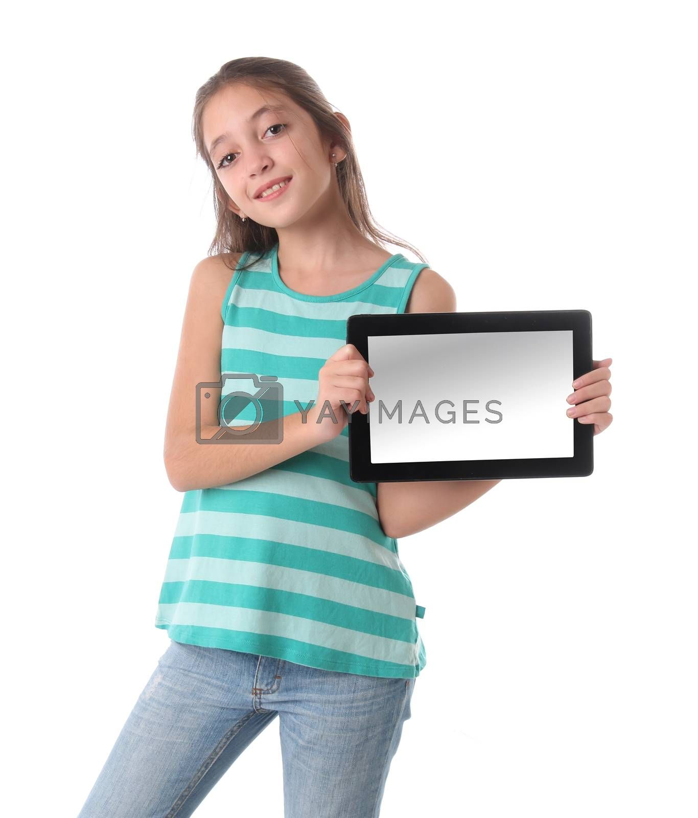 Beautiful pre-teen girl with a tablet computer. Isolated. Clipping path for the screen