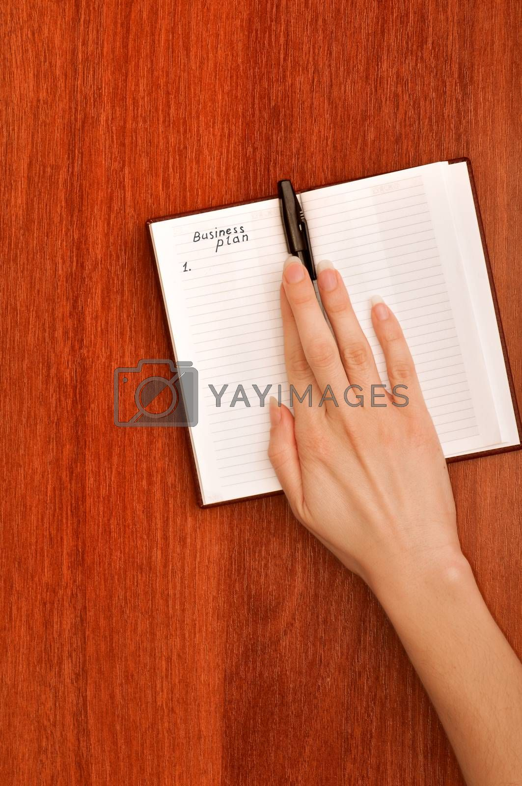 business woman create notes for business plan