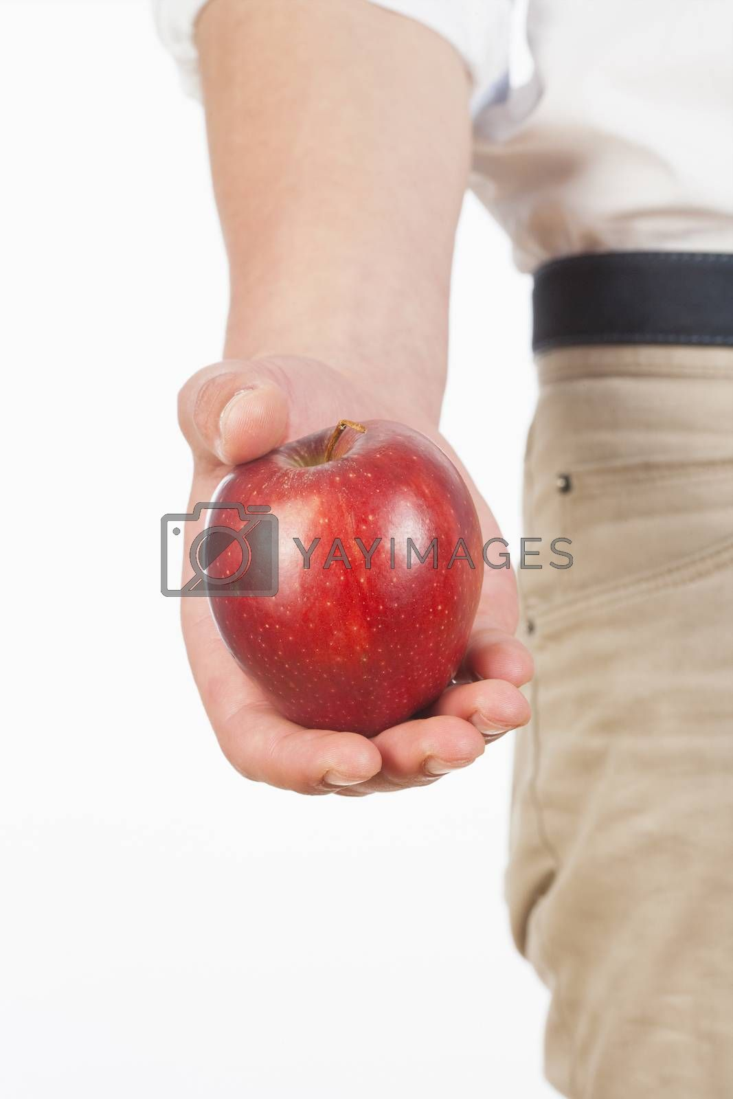 Royalty free image of Hand Holding Red Apple Against White Background by courtyardpix