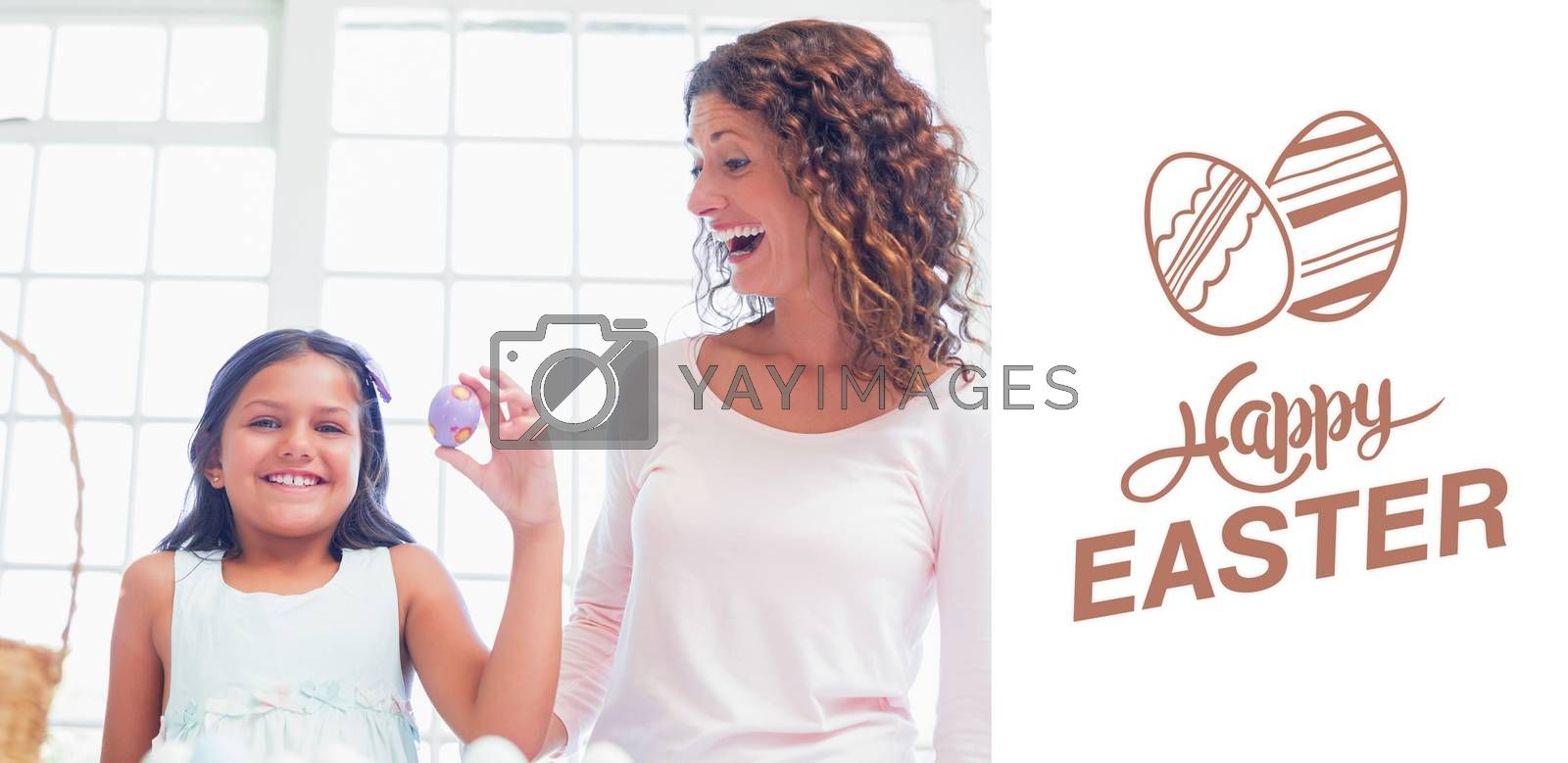 Happy girl holding easter egg  against happy easter graphic