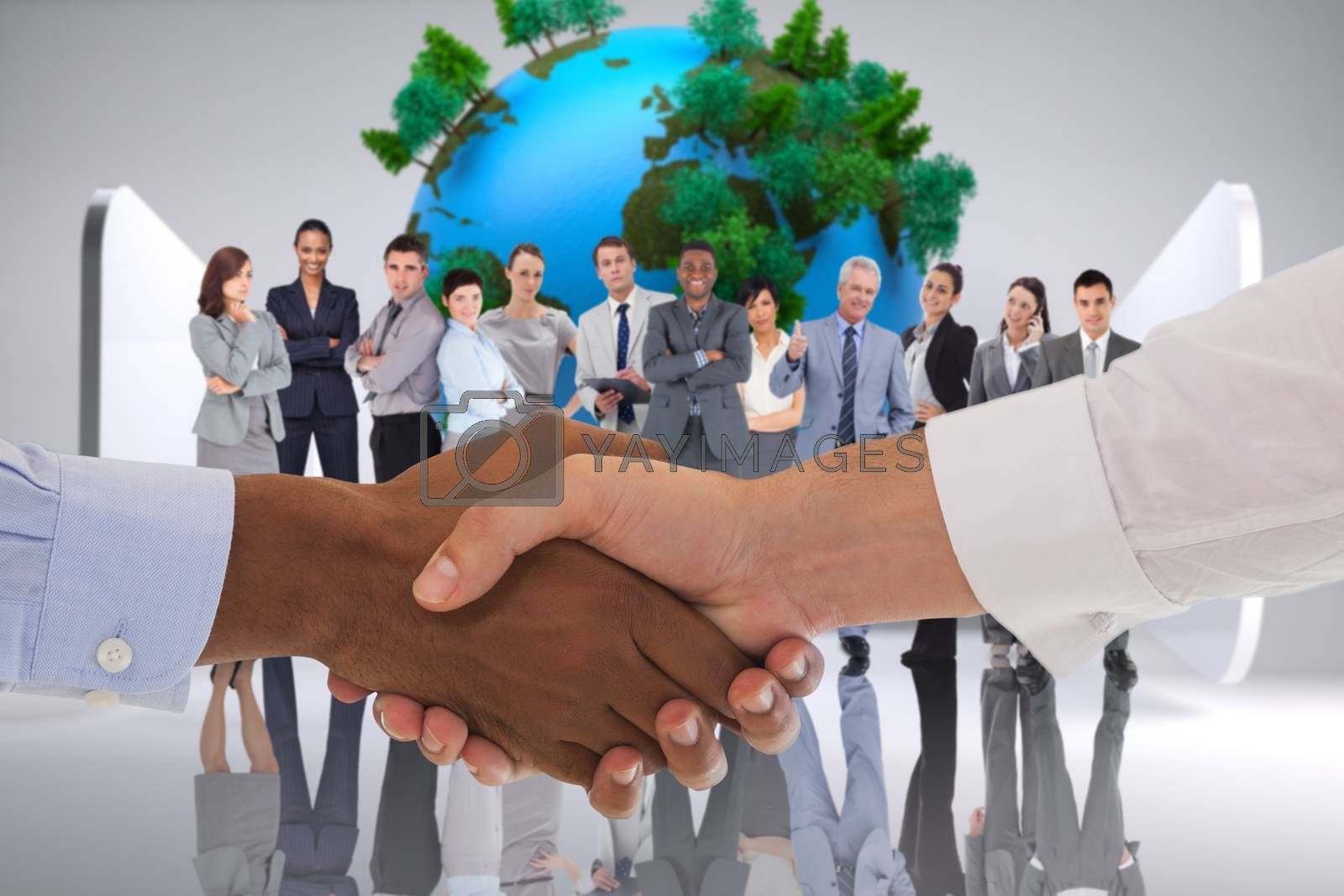 Close-up shot of a handshake in office against earth on abstract grey background