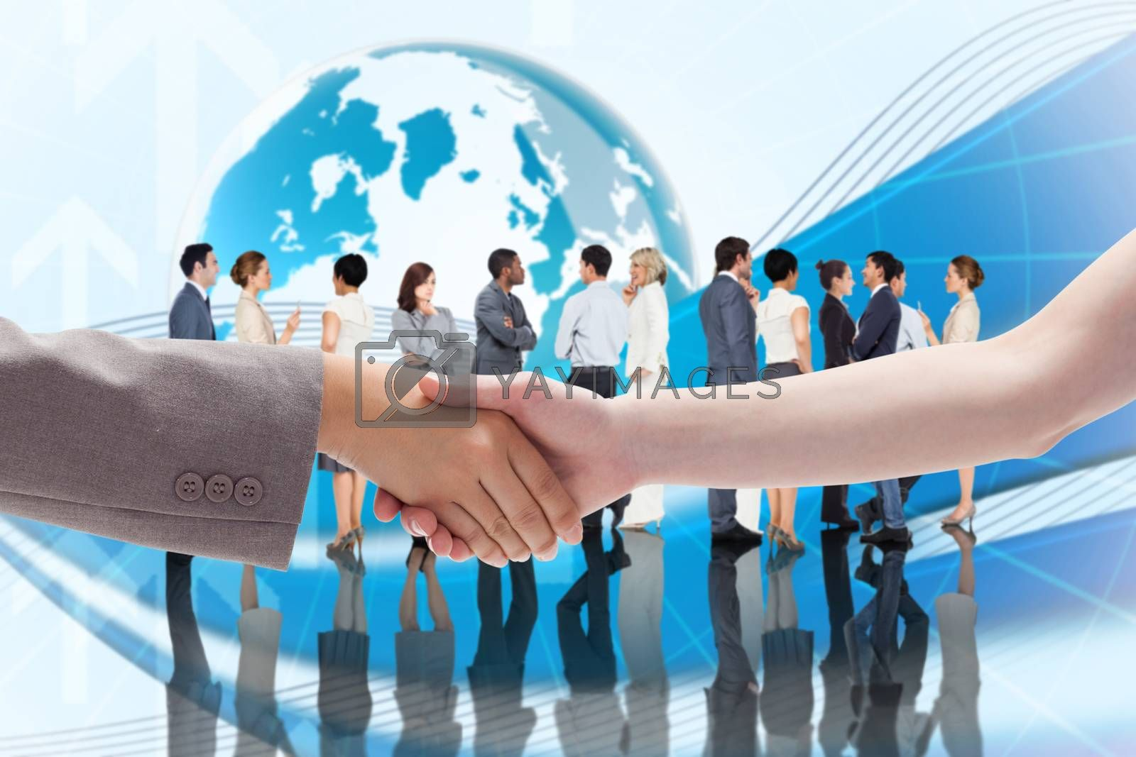 Handshake between two women against global business graphic in blue