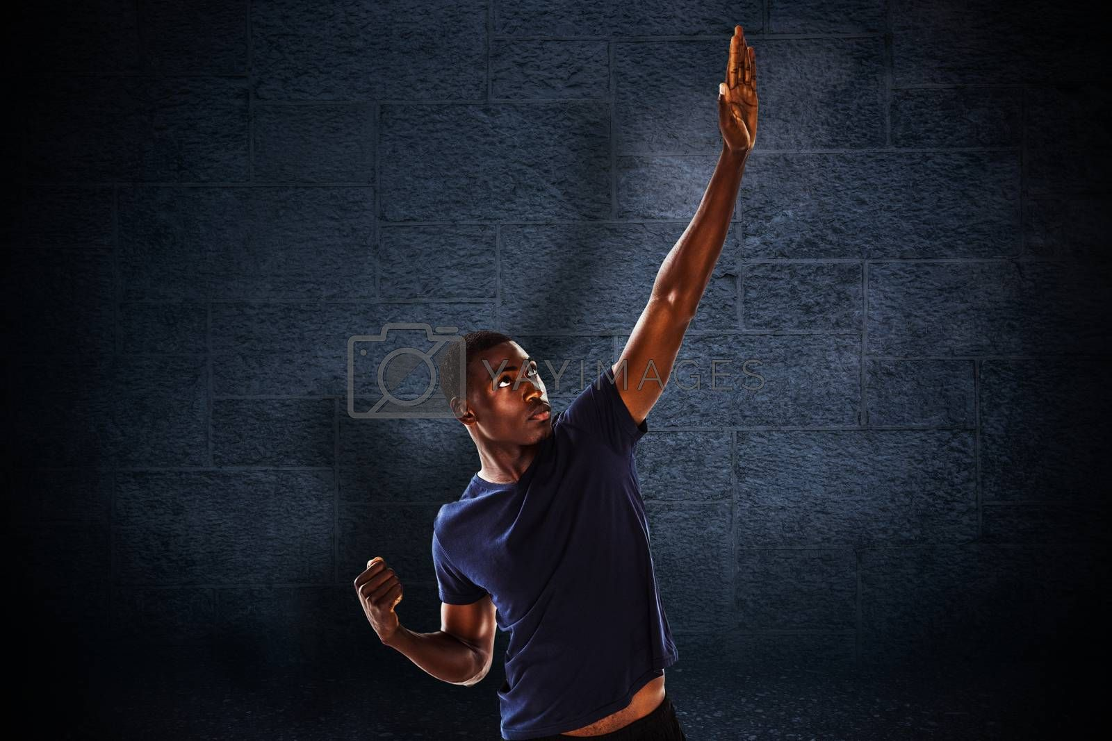 Serious young man with hand gestures against black background