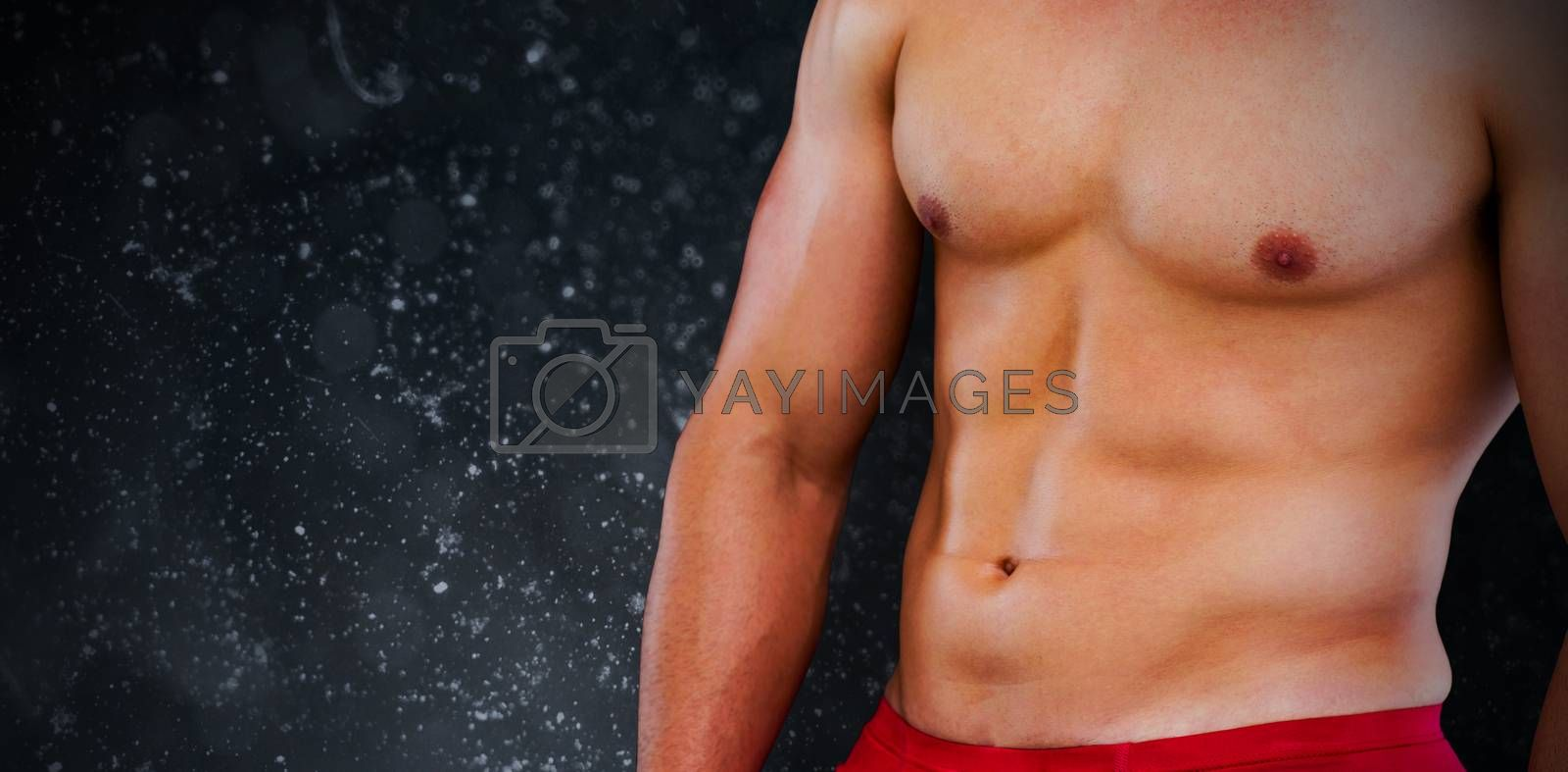 Bodybuilder  against black background