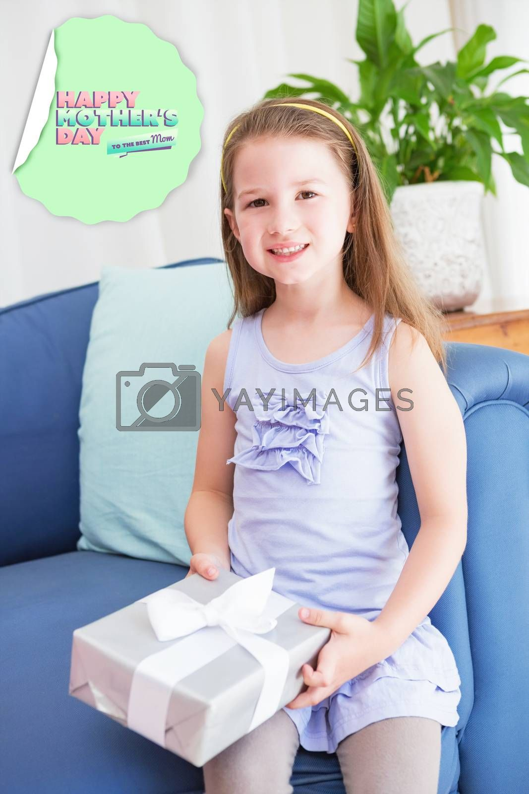 mothers day greeting against little girl holding a gift