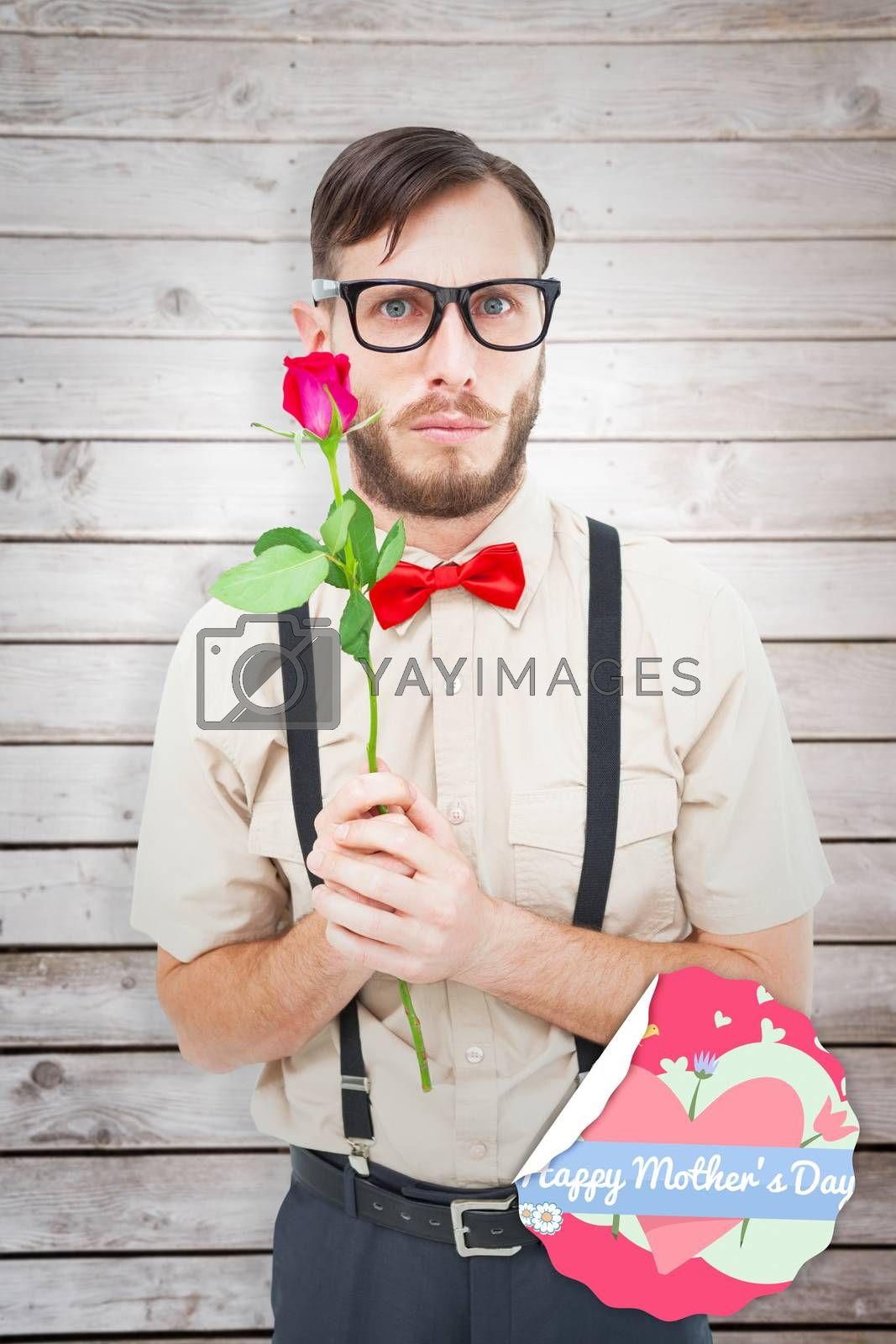 Geeky hipster offering a rose against wooden planks