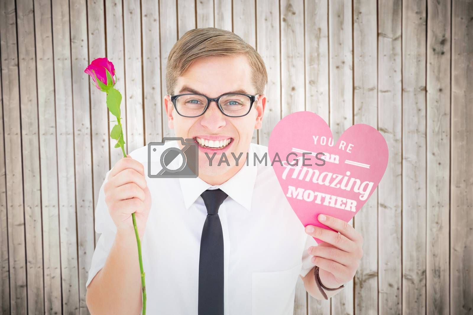 Geeky hipster holding a red rose and heart card against wooden planks background