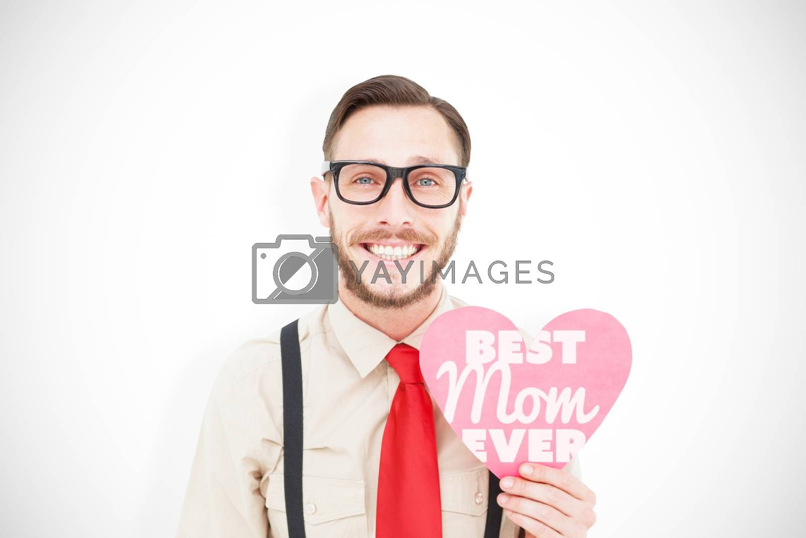 Geeky hipster smiling and holding heart card against best mom ever