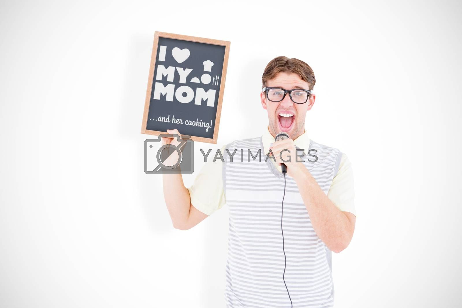 Geeky hipster holding blackboard and singing into microphone against mothers day greeting