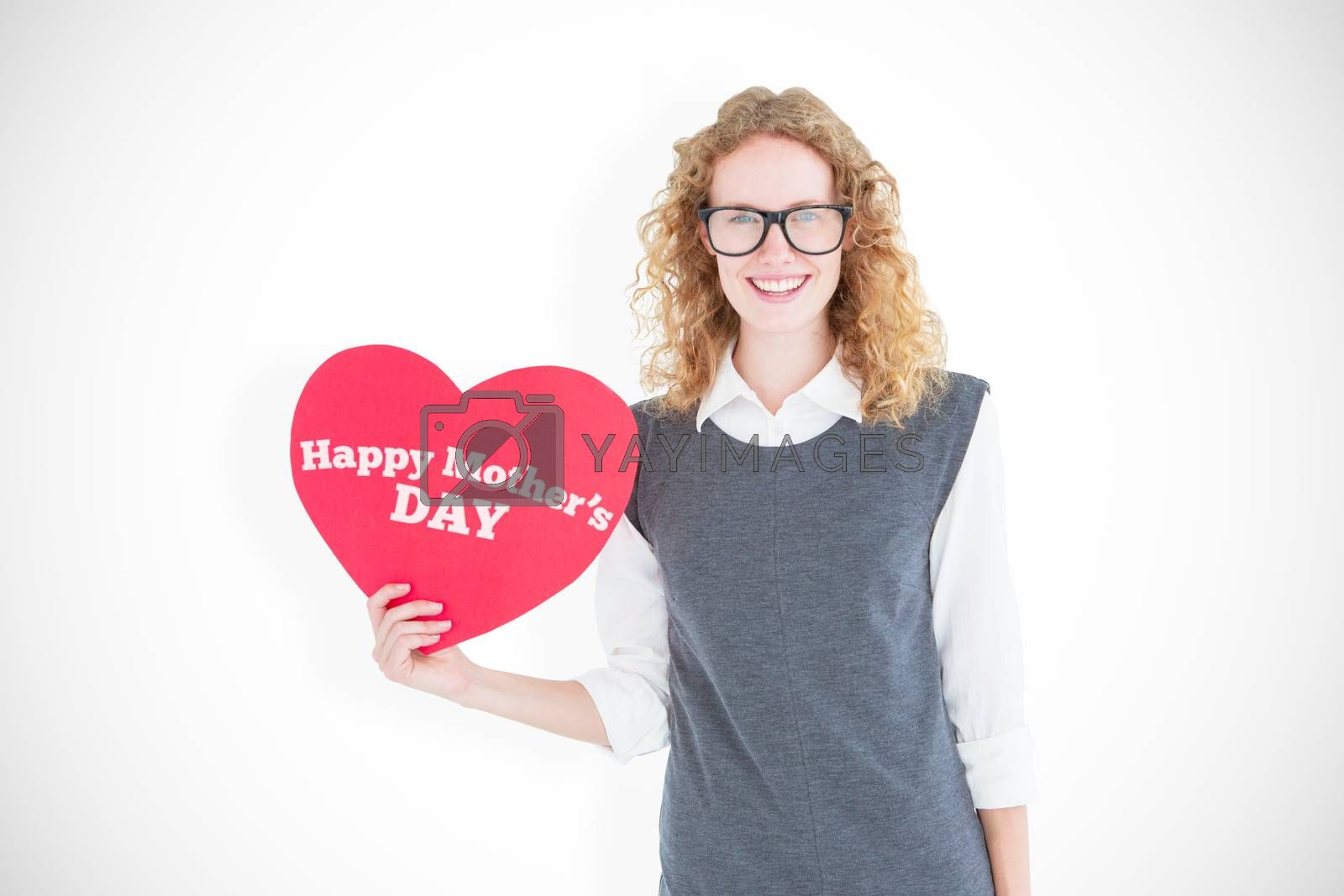 Geeky hipster holding heart card against mothers day greeting