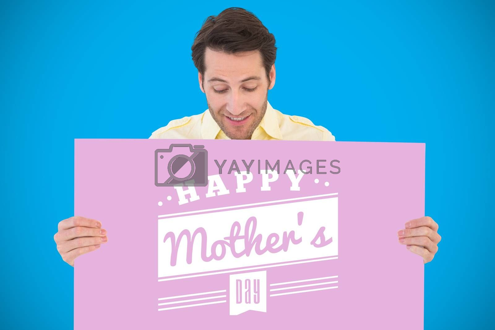 Attractive man smiling and holding poster against blue background with vignette