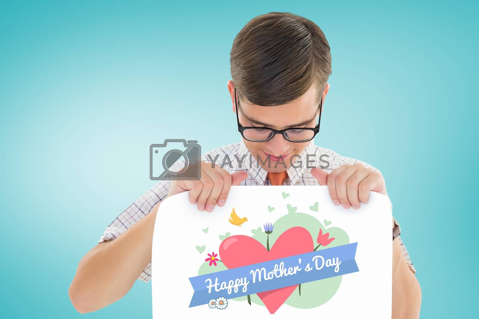 Geeky hipster smiling and showing card against blue vignette background