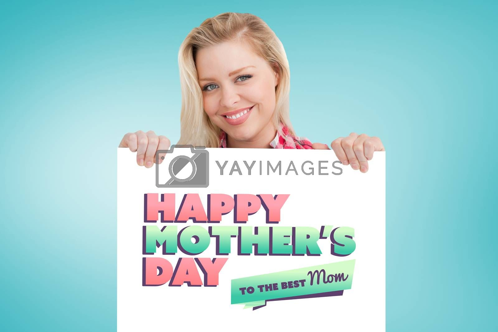 Woman beaming while holding a blank sign against blue vignette background