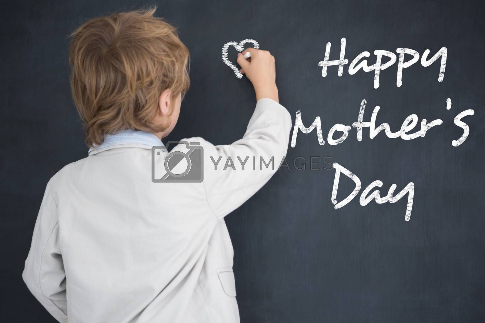 Cute pupil writing on board against black background