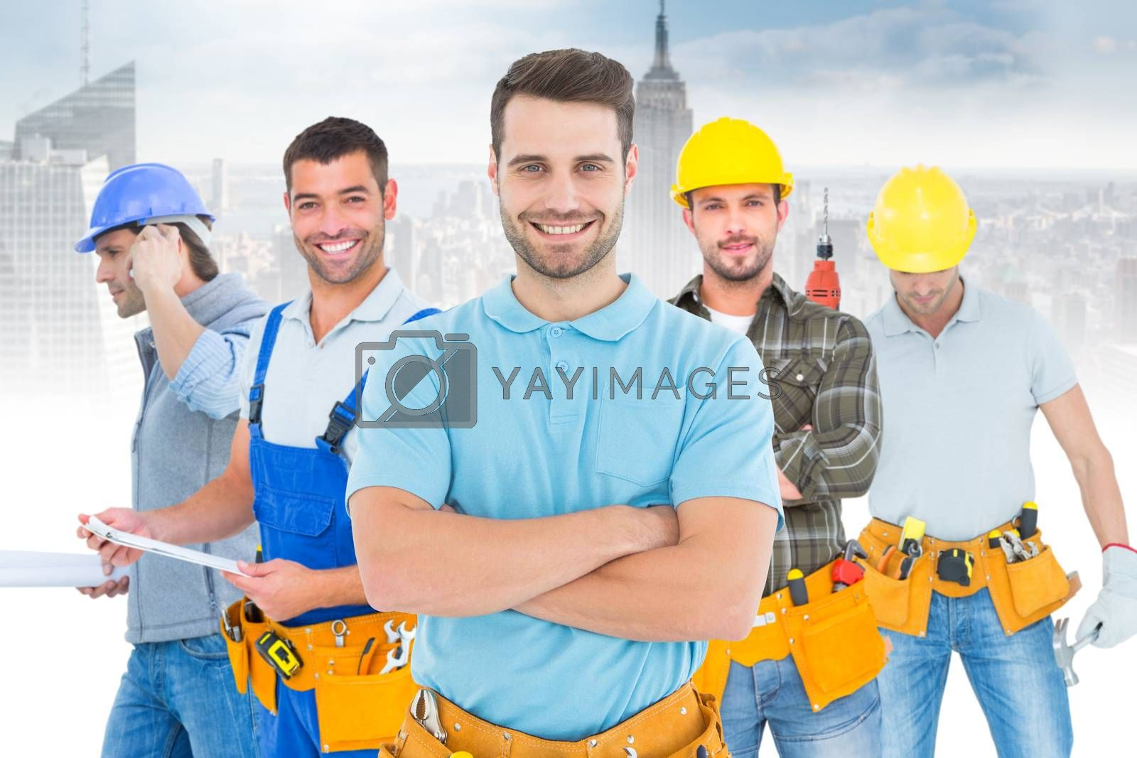 Composite image of happy carpenter standing arms crossed