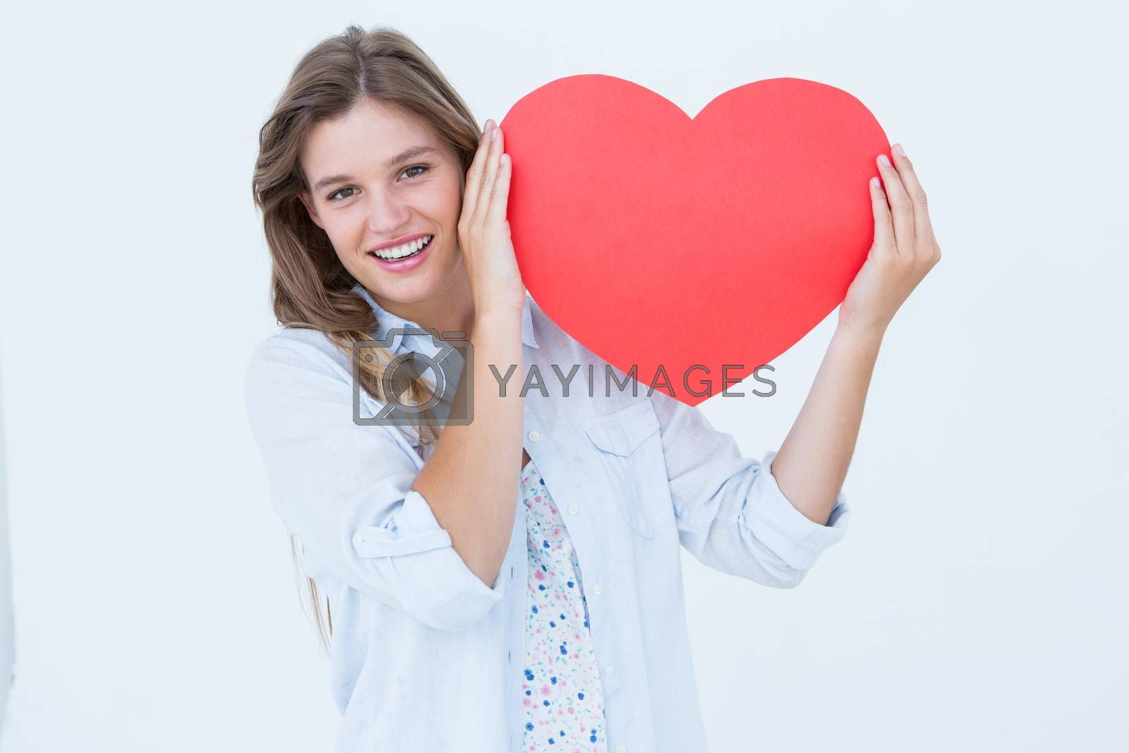 Woman holding heart card on white background