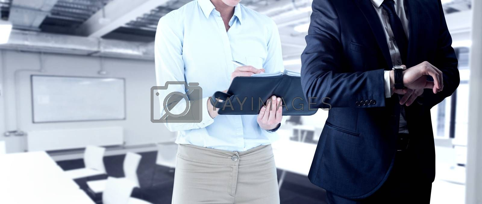 Handsome businessman checking the time against classroom