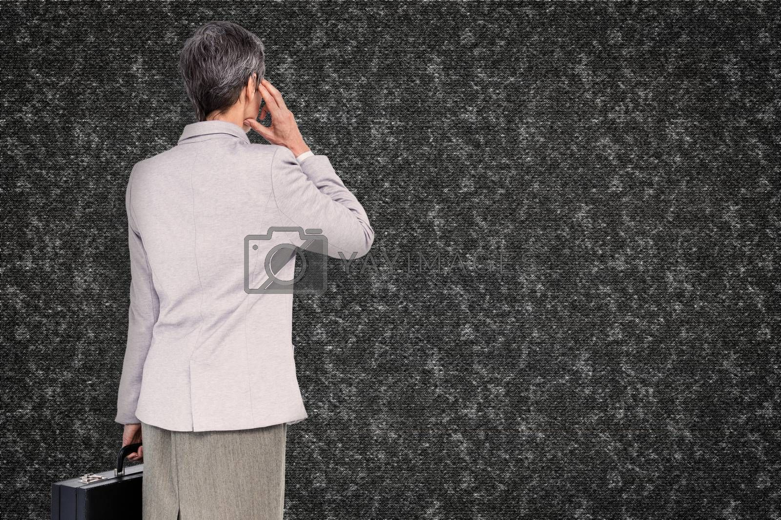 Businesswoman on the phone against black background