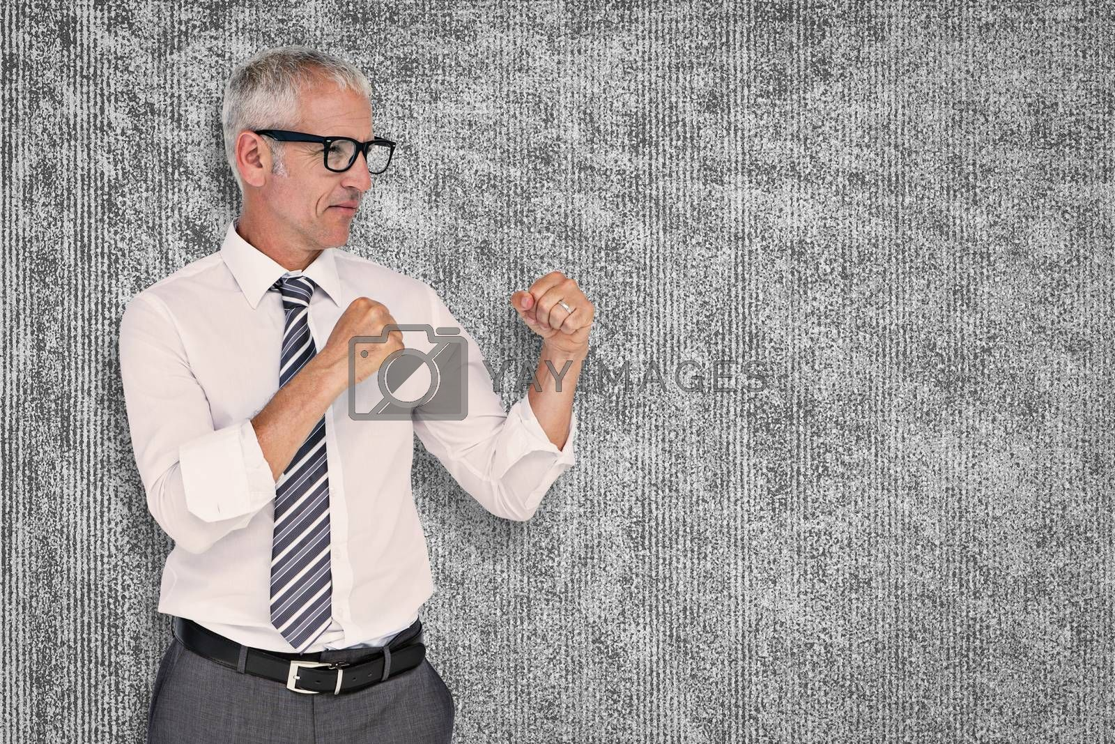Boxing businessman against grey background