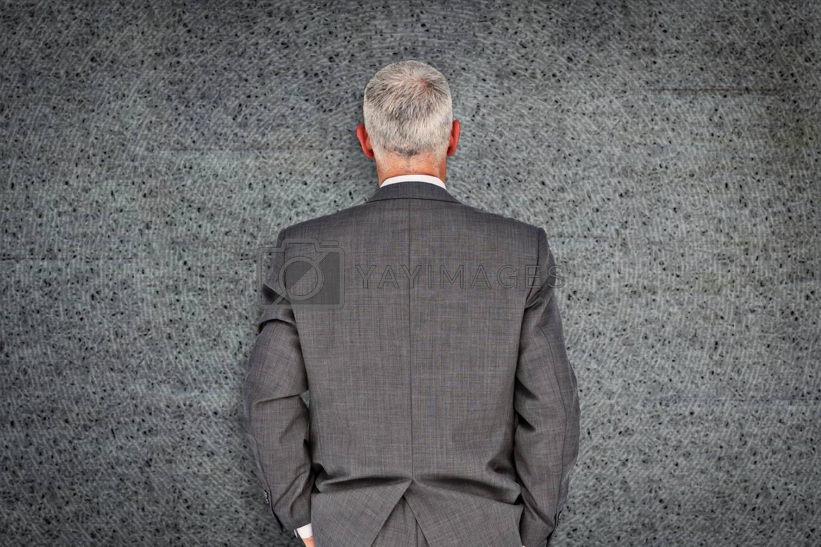Businessman against grey background