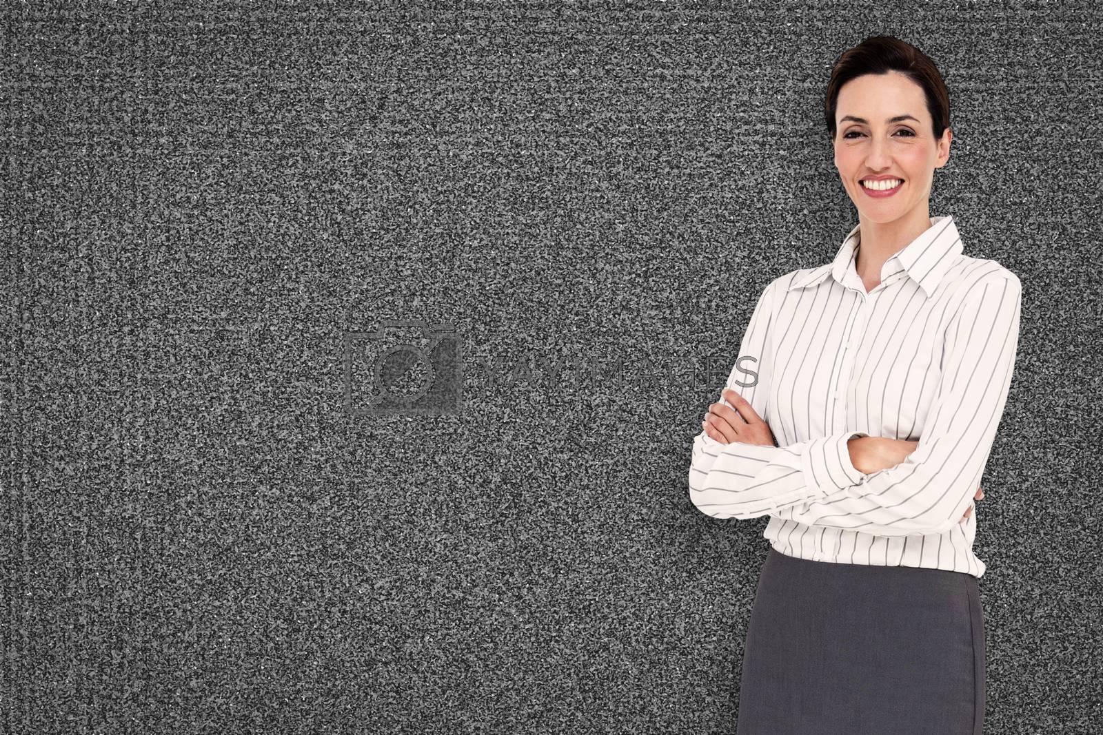 Smiling businesswoman against black background