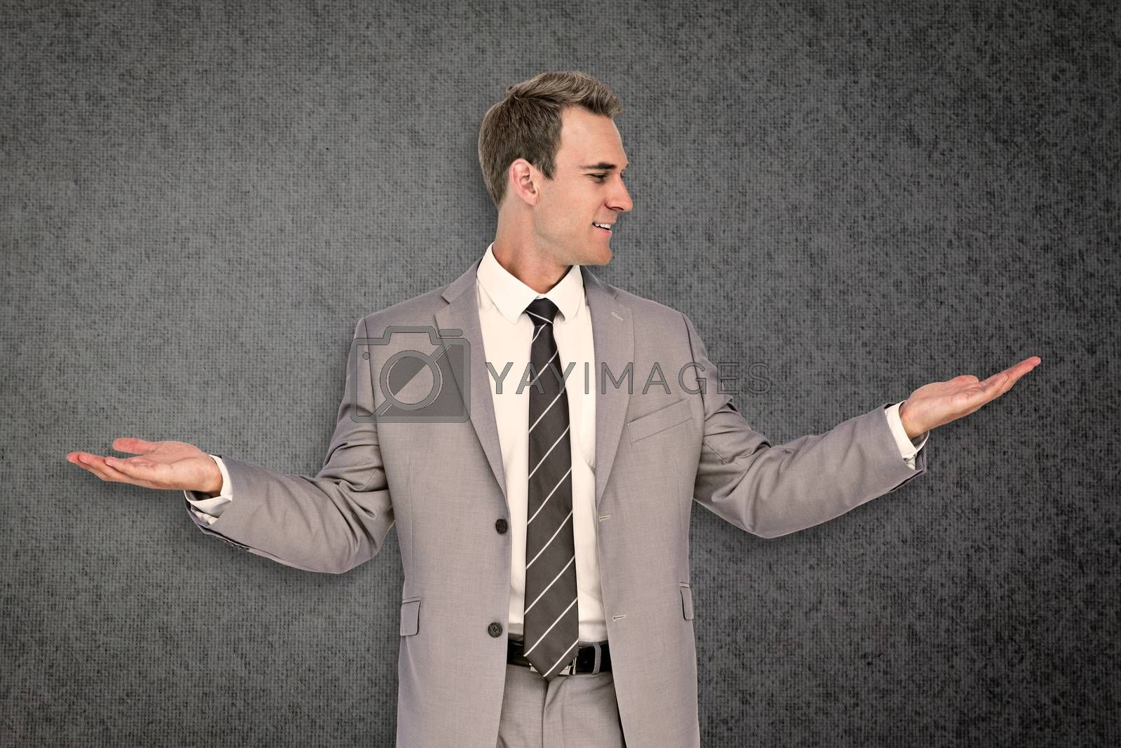 Businessman with hands out against grey background