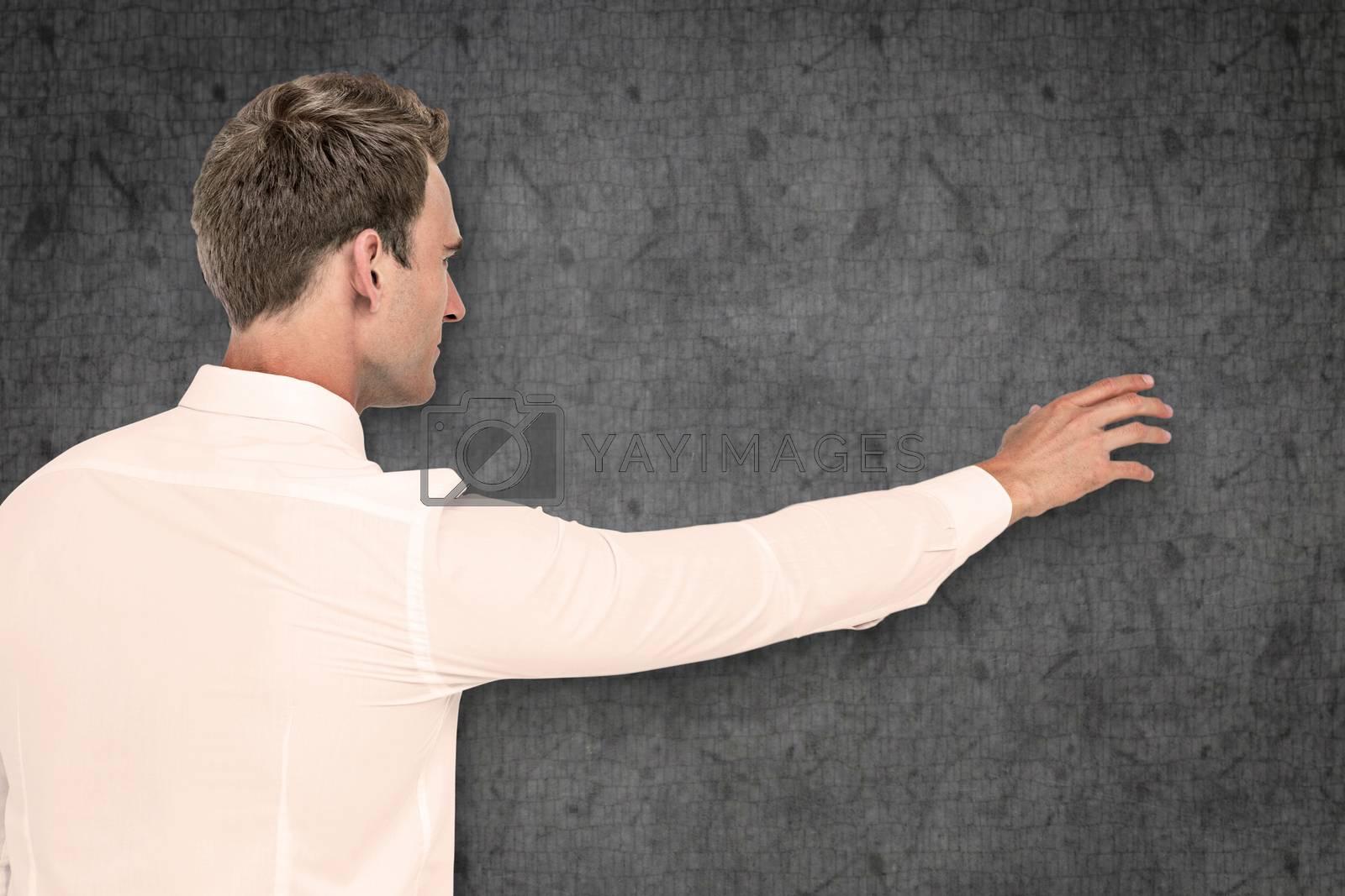 Businessman reaching against grey background