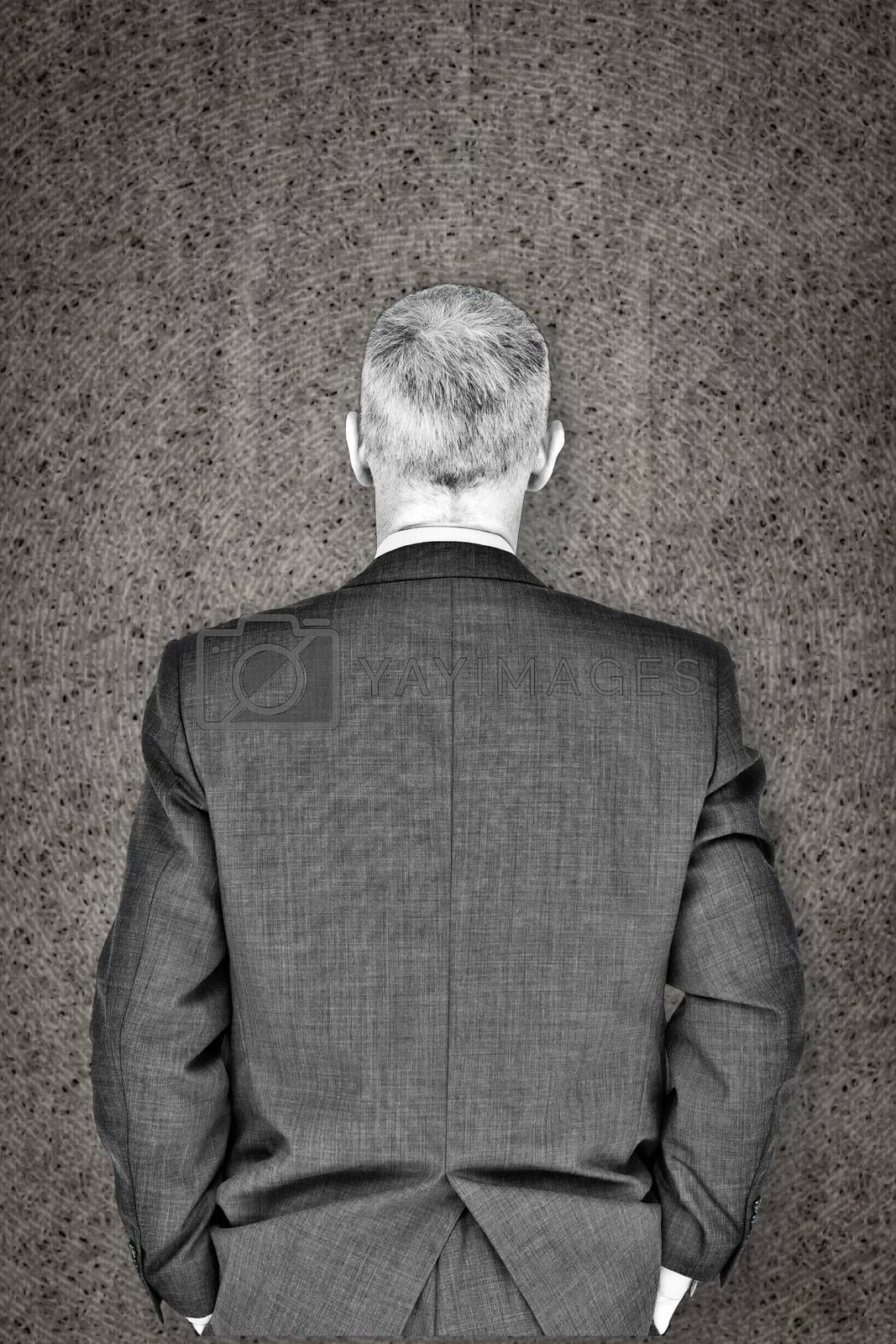Businessman against grey background