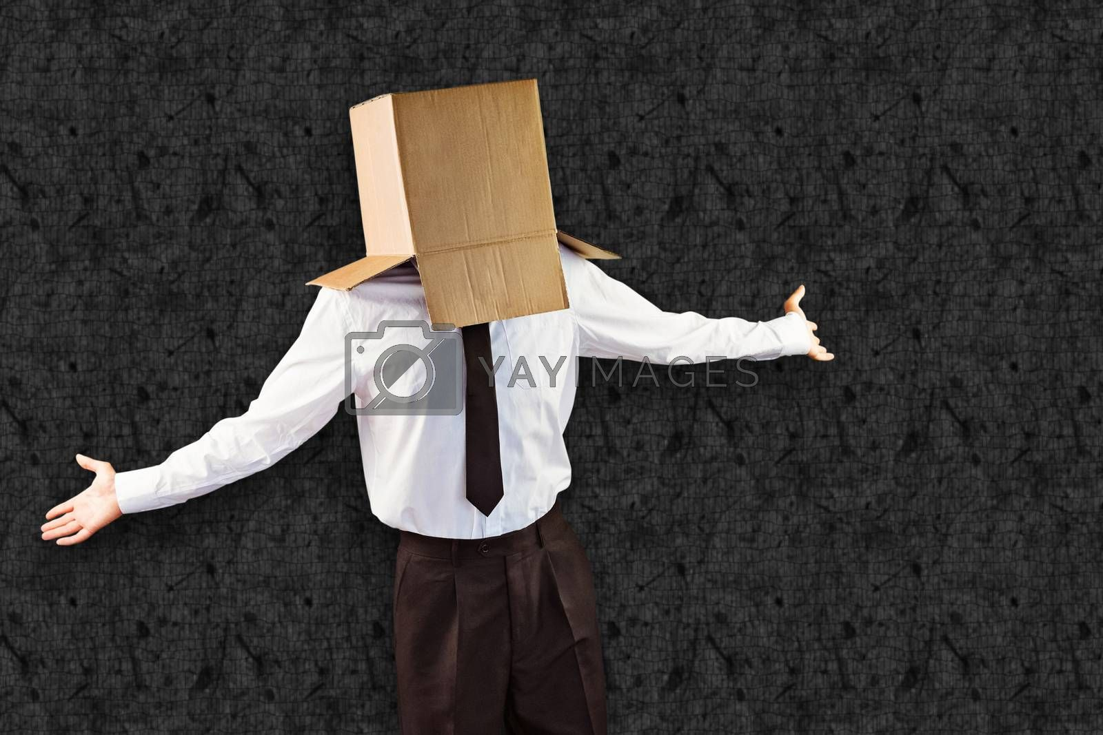 Anonymous businessman with arms out against grey background