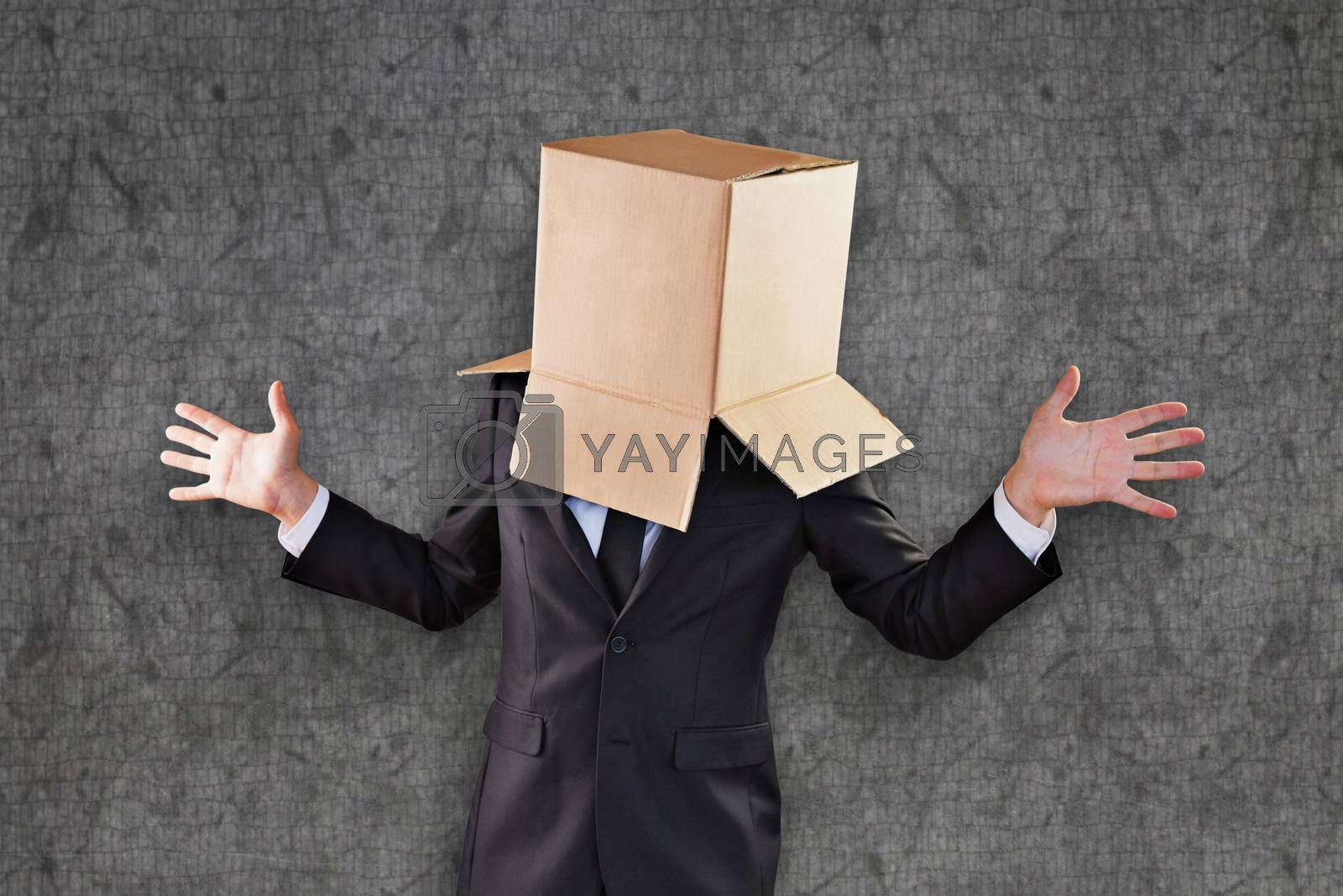 Anonymous businessman with hands out against grey background