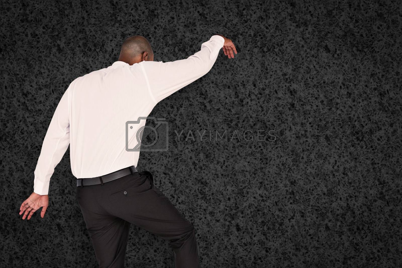 Businessman stepping against grey background