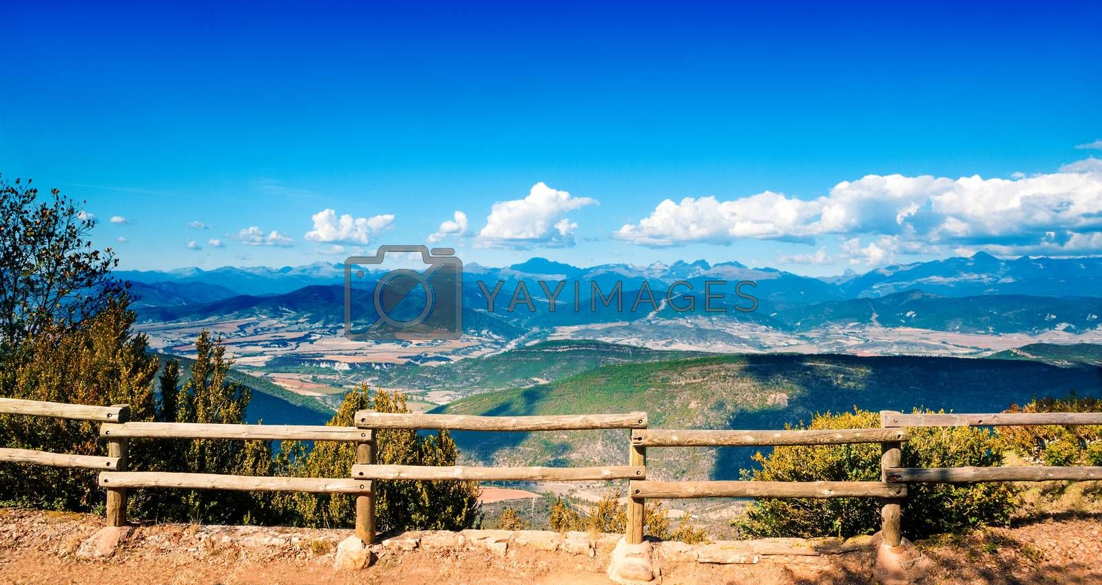 Panoramic landscape with mountains and wooden fence
