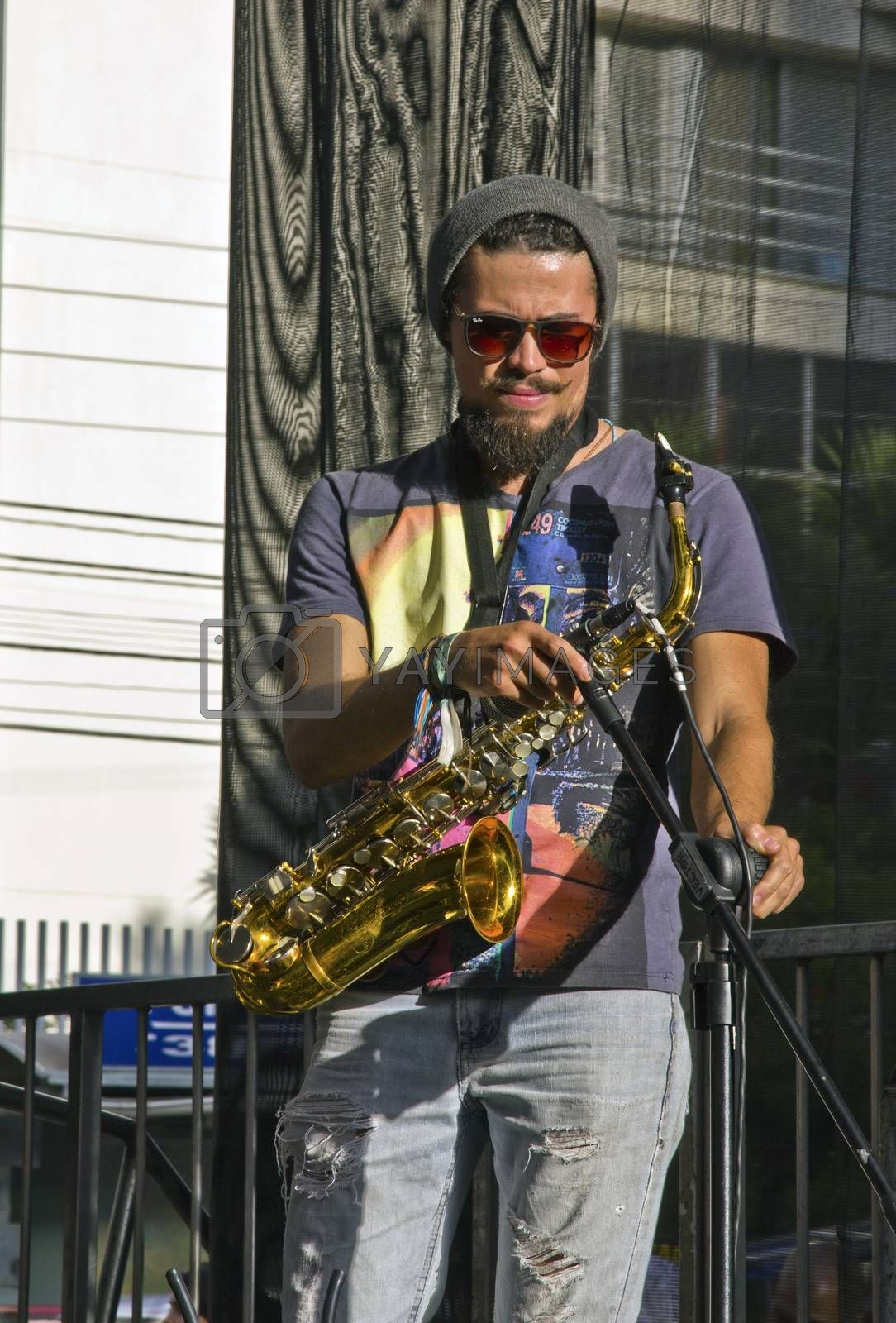 SAO PAULO, BRAZIL - MAY 17, 2015: An unidentified musician  playing saxophone on the street in Sao Paulo, Brazil.