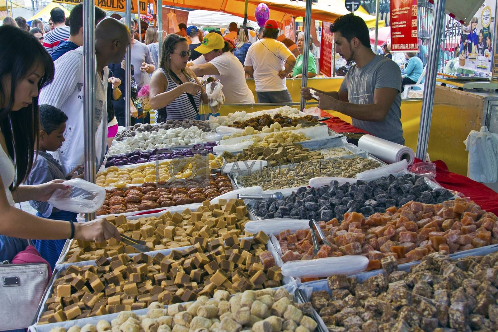 SAO PAULO, BRAZIL - MAY 17, 2015: An unidentified group of people in the hand made sweet stand at a street fair market in Sao Paulo.