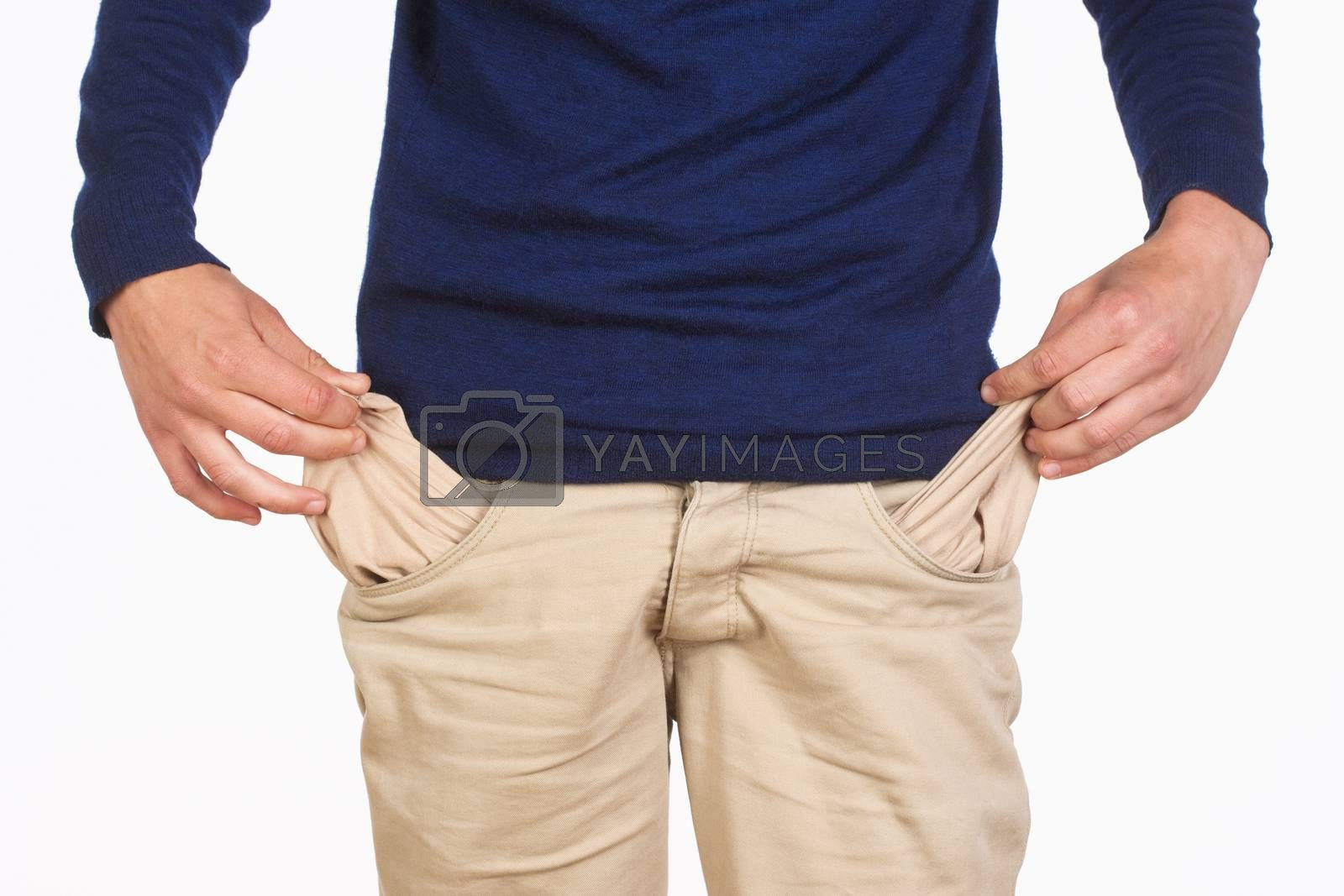 Royalty free image of Man Searching for Cash in his Pockets by courtyardpix