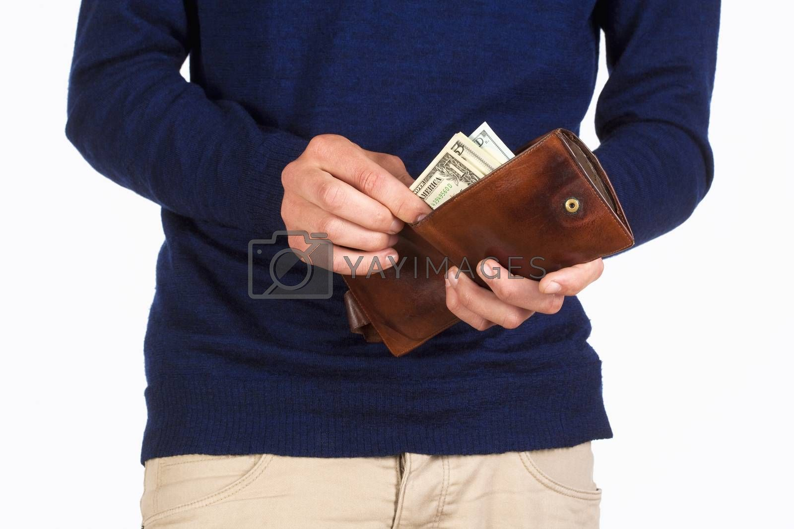 Royalty free image of Man Holding a Wallet and Counting Dollars by courtyardpix