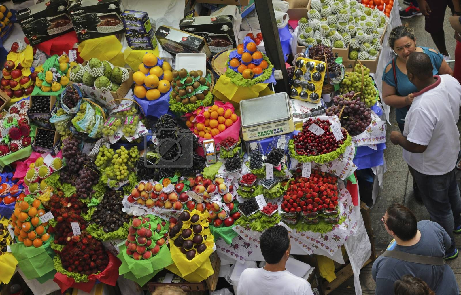 SAO PAULO/BRAZIL - MAY 9: An unidentified man at a fruit stand in Central Market of Sao Paulo on May 09, 2015. This landmark is a destination for tourists and locals.
