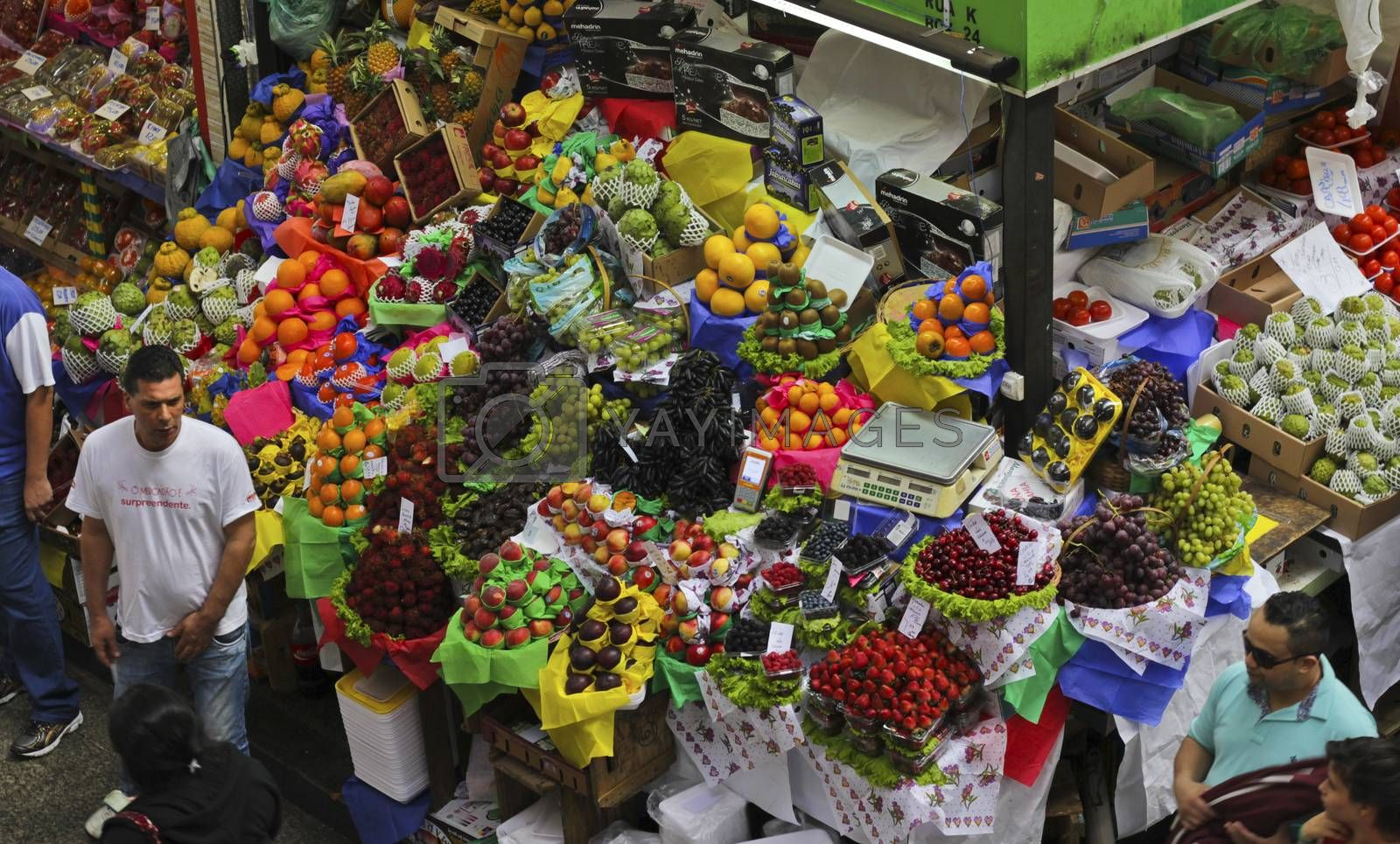 SAO PAULO/BRAZIL - MAY 9: An unidentified men a fruit stand in Central Market of Sao Paulo on May 09, 2015. This landmark is a destination for tourists and locals.