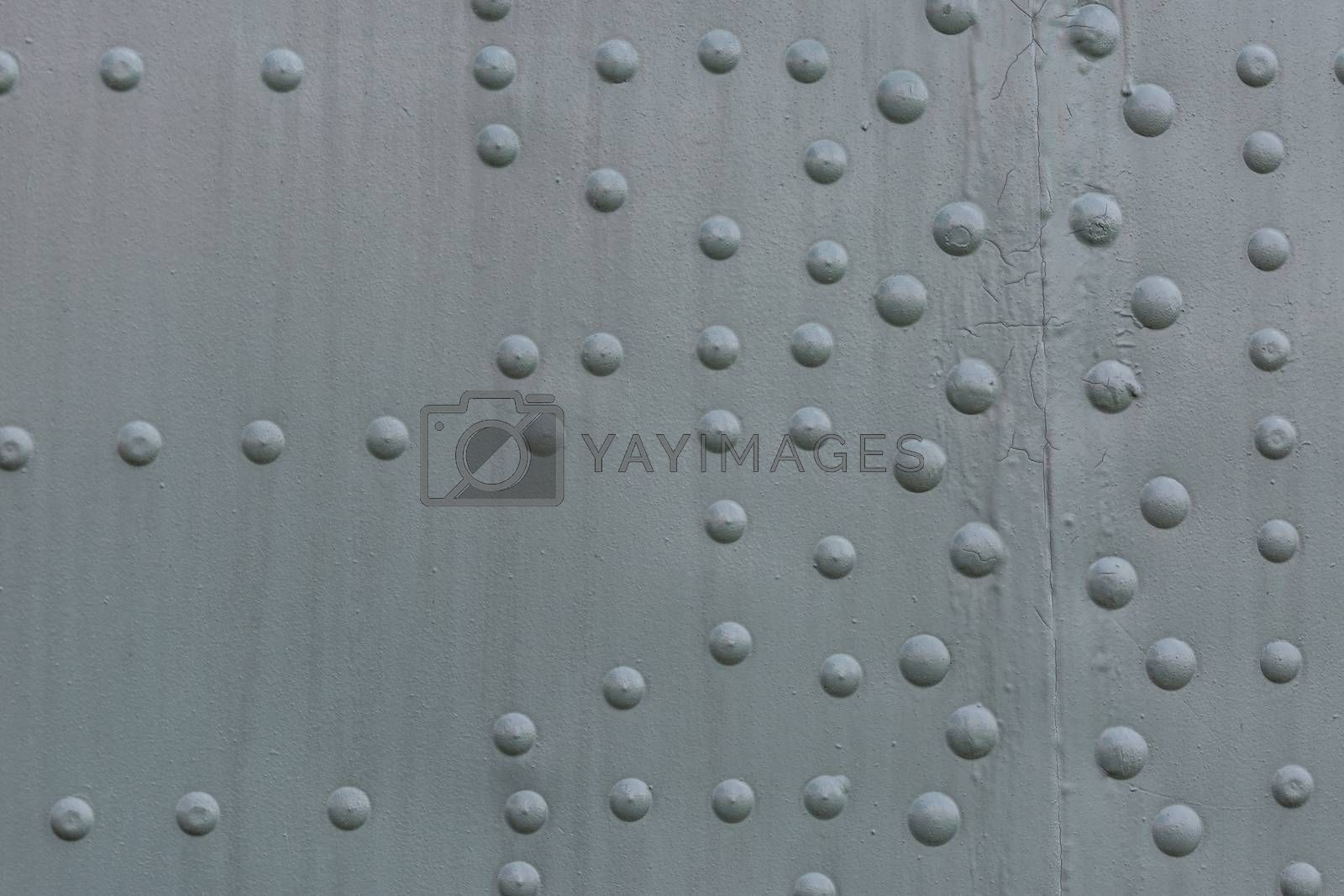 Old gray steel riveted surface