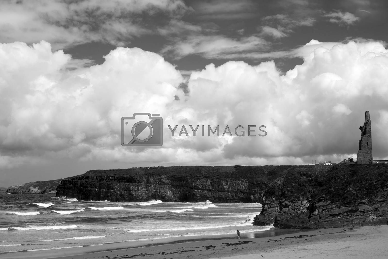 young woman on the beach with cliffs and castle on ballybunion beach county kerry ireland
