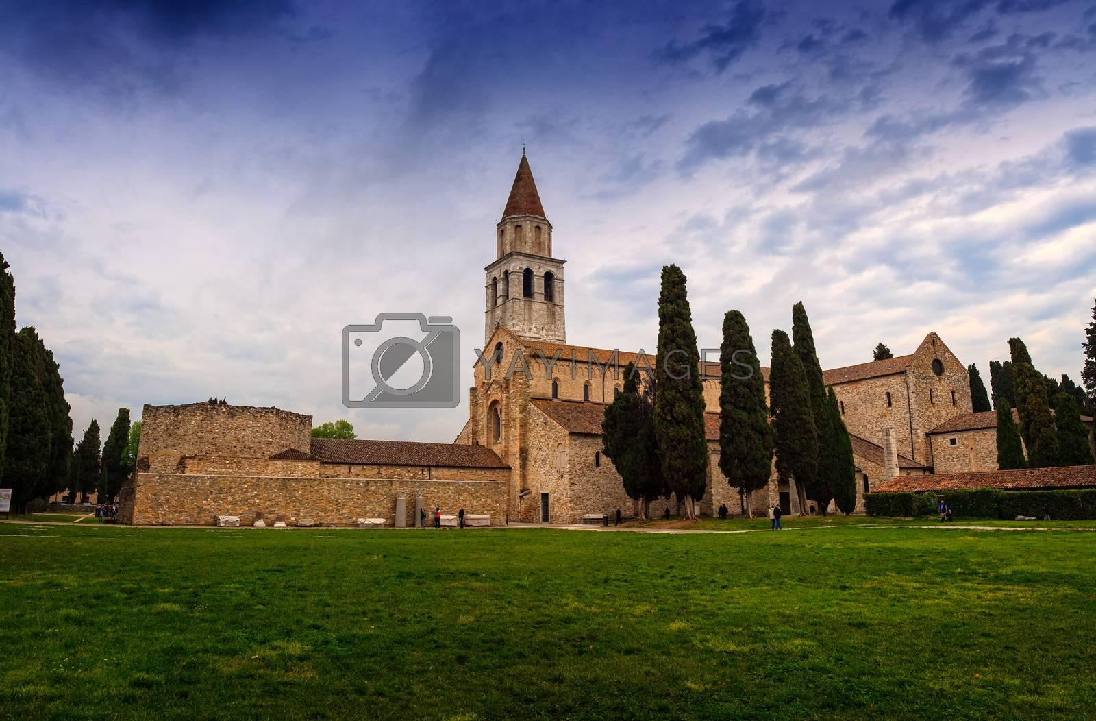 View of Basilica di Santa Maria Assunta and bell tower of Aquileia, Italy. Aquileia is UNESCO World Heritage Site