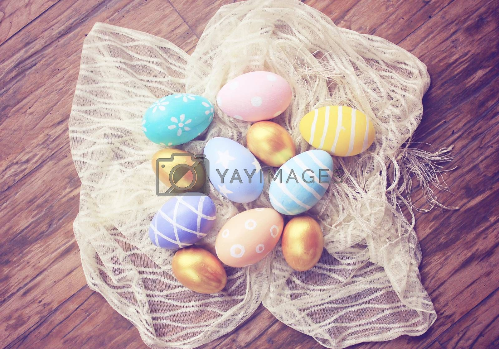 Top view of colorful easter eggs on cloth with retro filter effect