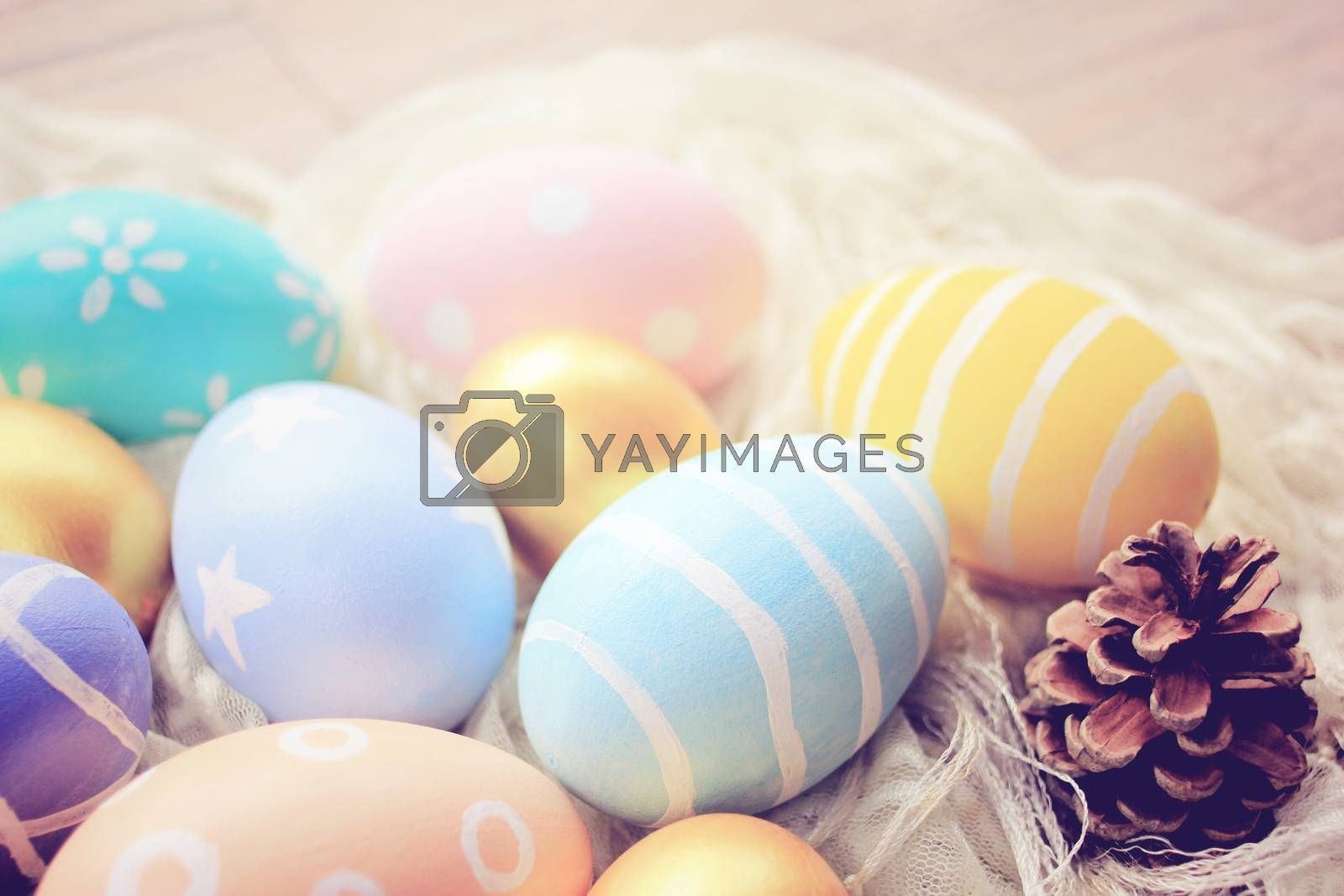 Pastel easter eggs on cloth with retro filter effect