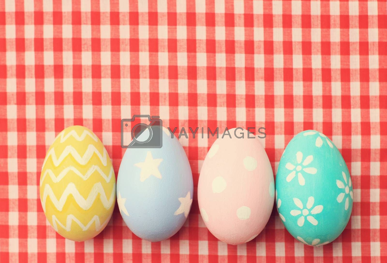 Colorful easter eggs on tablecloth with retro filter effect