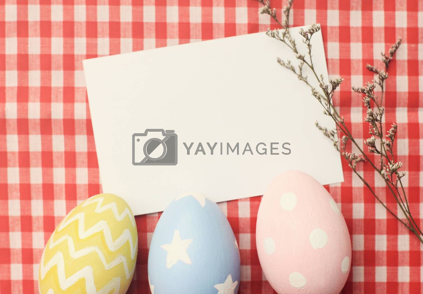 Colorful easter eggs and blank note paper with retro filter effect