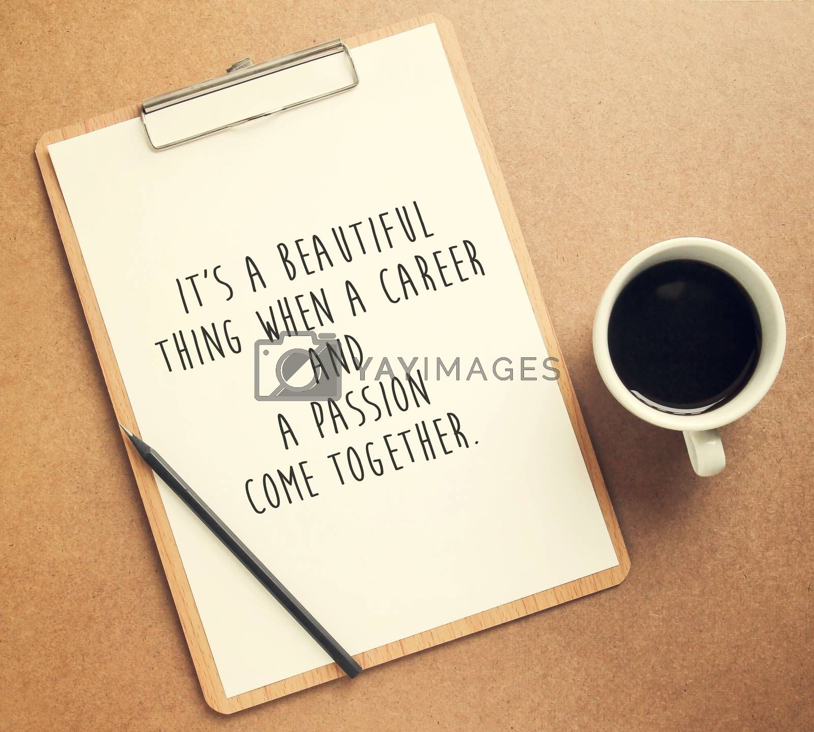 Inspirational motivating quote on clipboard and cup of coffee with retro filter effect